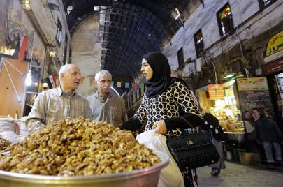 A Lebanese tourist buys nuts at the Hamidiyeh popular market in the old part of the capital Damascus in 2016.