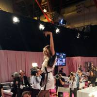 Candice Swanepoel dances on a table backstage