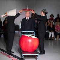 Mad Hatters And Their Giant Apple