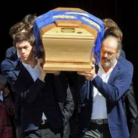 The coffin of Ottavio Missoni is carried into the Basilica