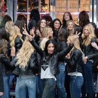 Adriana Lima holds court outside the Victoria's Secret Bond Street store