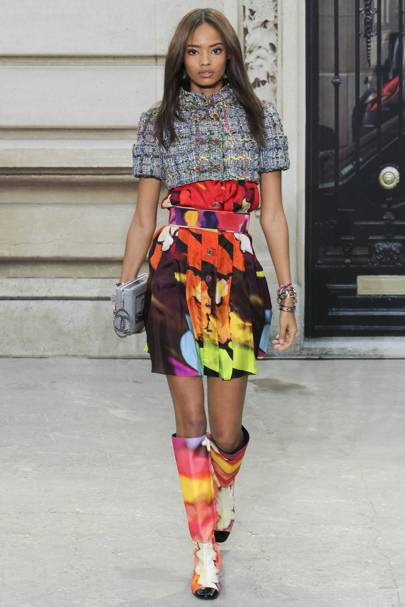 Malaika at the Chanel show that turned into a fashionable protest.