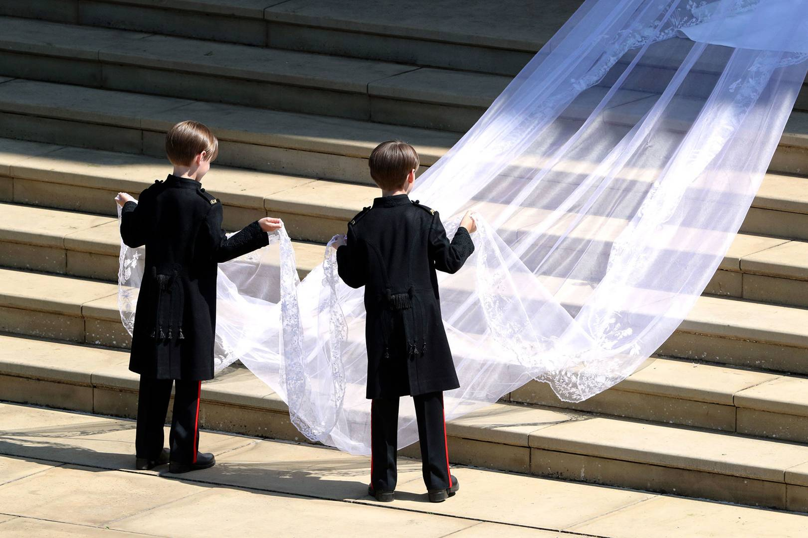 Meghan's wedding veil being carried by her two page boys