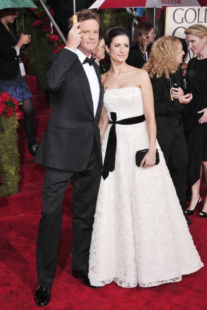 "JANUARY 2010 - Colin Firth, who was nominated for the Best Performance by an Actor in a Motion Picture - Drama for [i]A Single Man[/i], in Tom Ford, with wife Livia in a re-purposed Christiana Couture dress   <A target=""_blank"" href=""http://www.vogue.co.uk/blogs/livia-firth/default.aspx"">READ ABOUT LIVIA'S GREEN CARPET CHALLENGE IN BLOGS</a>"