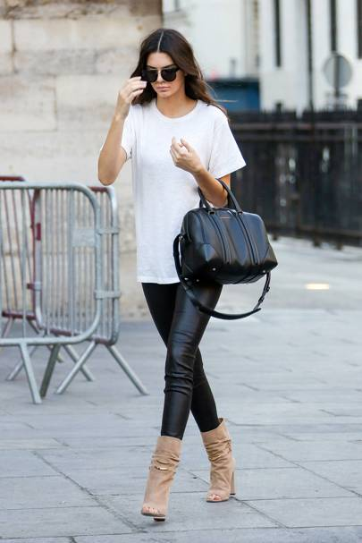 34a89369 Relaxed and oversized, this white T-shirt with black leather leggings  became a signature KJ look.