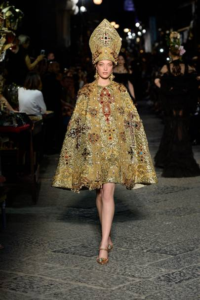 The collection featured Catholic religious influences like a brocade cape with a papal pointed cap.