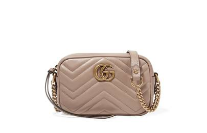 44f34cbef94 Gucci. Gucci. Channel Alessandro Michele s retro vision and wear Gucci s  iconic Marmont crossbody bag with camel and jewel tones. GG Marmont camera  mini ...