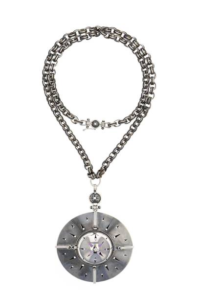 "The ""Sirius"" necklace in closed position, with a star shaped cut-out ""cover"" to help absorb and emit light"