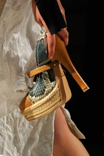 3290a067a8e0 PRADA SPRING SUMMER 2009 - Prada s spring summer 2009 heels were so  perilously high that two models fell to their knees while attempting to wear  them on the ...