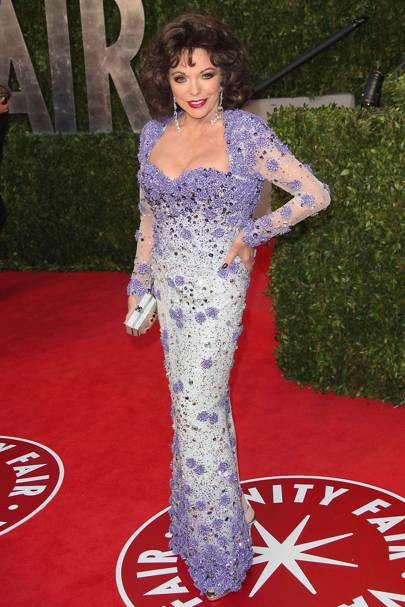 """FEBRUARY 2011 - Joan Collins, in Georges Hobeika, at the [i]Vanity Fair[/i] post-Oscars party.   <A target=""""_blank"""" href=""""http://www.vogue.co.uk/celebrity-photos/100305-best-ever-oscars-dresses.aspx"""">[b]SEE THE BEST EVER OSCAR DRESSES[/b]</a>    <A target=""""_blank"""" href=""""http://www.vogue.co.uk/celebrity-photos/100305-worst-ever-oscars-dresses.aspx"""">[b]SEE THE WORST EVER OSCAR DRESSES[/b]</a>"""