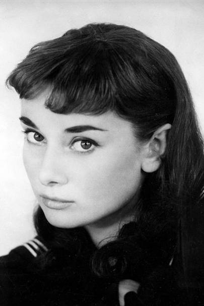 0ff7ca3a001 1951 - Hepburn poses in character in her Broadway debut of Gigi, sporting a  short fringe and shoulder-length hair.