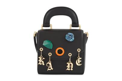 Christopher Kane's grained black leather Bonnie bag comes with a strap that can be removed depending on your mood