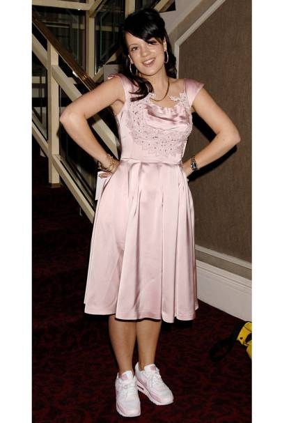 89224df213 MAY 25 2006 - She wore a pink satin vintage dress with matching Nike  trainers - a combination that she would become famous for - at the Ivor  Novello Awards ...