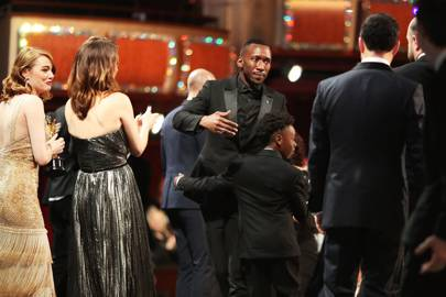 Moonlight star Mahershala Ali arrives on stage to celebrate with his fellow castmates and crew members