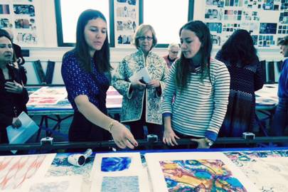 Gladys Perint Palmer watches on as guest mentor Margherita Missoni talks to a student of the Academy of Art University in San Francisco