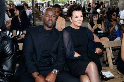 Kris Jenner, sitting front row at Givenchy, watches her daughter Kendall model couture