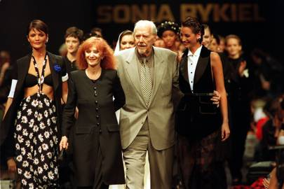 Sonia Rykiel takes a bow in 1993 with, from left, Helena Christensen, film director Robert Altman, and Christy Turlington. Altman was inspired to write his film, Pret A Porter (1994), after watching a Rykiel show.