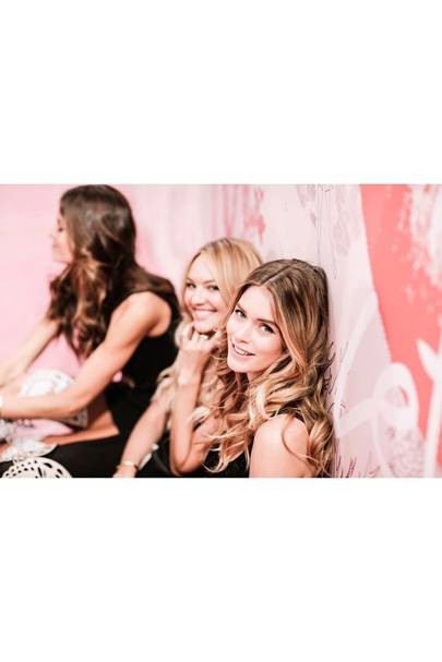 Doutzen Kroes and Candice Swanepoel share a joke backstage on the morning of the show