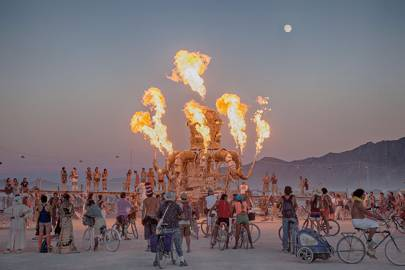 Stunned Burning Man festival-goers watch man run into flames