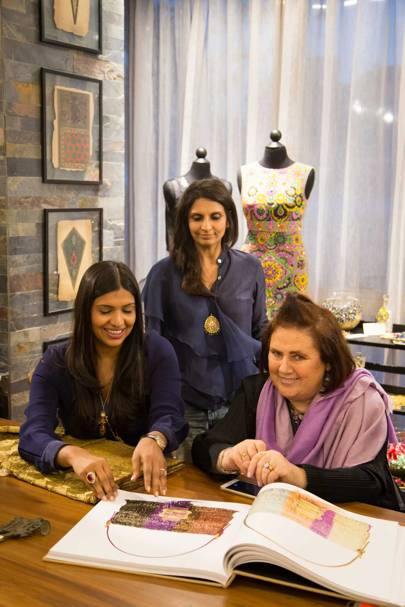 Suzy with Karishma Swali, Managing Director of Chanakya (seated left), and business and design partner Monica Shah, viewing a book filled with images of Fendi baguette bags embroidered by Chanakya