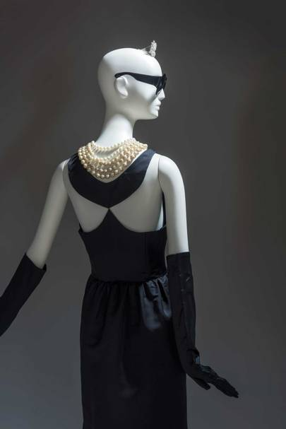 Seen from the back, the evening sheath dress worn by Holly Golightly, as played by Audrey Hepburn, in the Blake Edwards film, [i]Breakfast at Tiffany's[/i], 1961