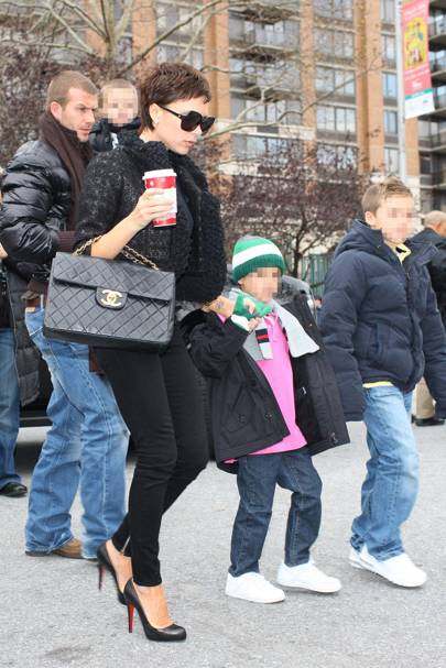 387b164d4ef7db ... David and Victoria Beckham took their three sons for a wintery walk  through Central Park. Clutching her Starbucks coffee, Victoria carried a Chanel  bag ...