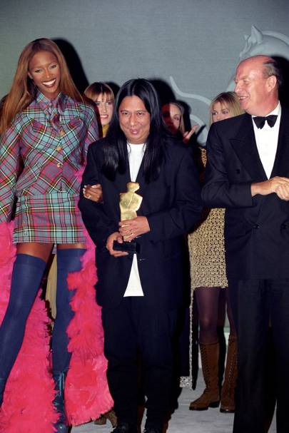 John with his British Fashion Award in 1993