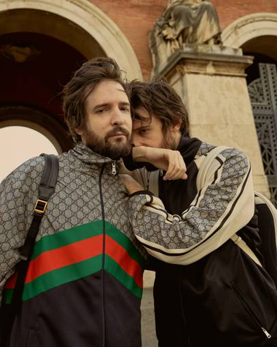 5a76e83c1 Fabio is wearing the Gucci print leather backpack, oversized jersey jacket;  Damiano wears another variation of the leather backpack and jersey jacket.