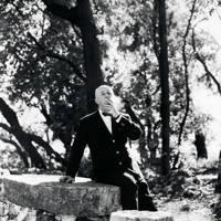 A cigarette break with Monsieur Dior in the garden of the Château de la Colle Noire.