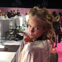 Lindsay Ellingson blows a kiss as she waits in hair and make-up