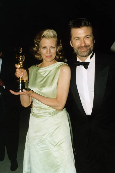 With her husband Alec Baldwin, holding her award for best supporting actress in 'L.A. Confidential' at the 70th Academy Awards in 1998