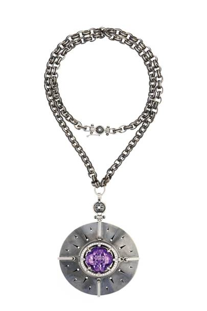 "A necklace from the ""Sirius"" collection in open position, which reveals diamonds suspended around an amethyst (shown), citrine, peridot or green garnet"