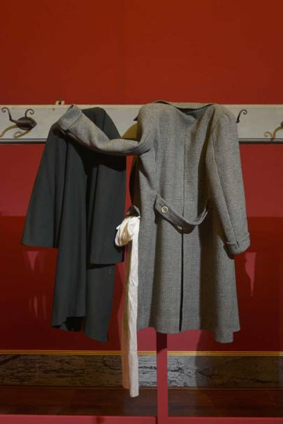 """Clothes Hanging, Waiting"": Left, overcoat in velvet and wool twill and silk satin by Carette & Philipponnat, June 1913 (gift of Viscount Xavier de la Tour); right, coat in checked wool twill by Evangelista, circa 1964 (gift of Boddano). To Saillard, ""garments awaiting bodies"" are the ""daily witnesses of our harried lives""."
