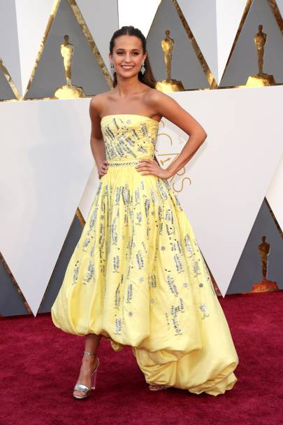 9e7b0df3592de Alicia Vikander chose a custom Louis Vuitton dress to collect her Best  Supporting Actress Oscar in 2016.