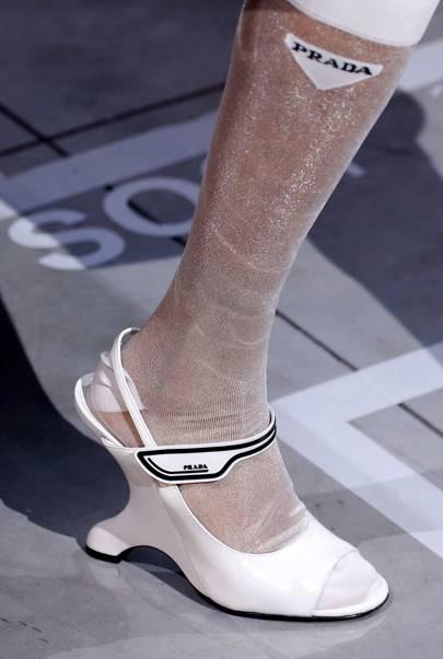 Sheer pop socks framed two shoe personalities