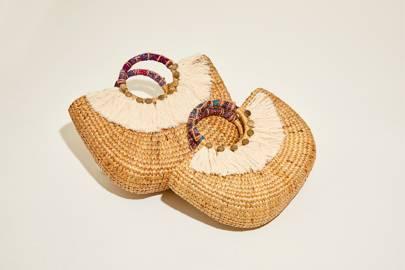 Woven half round handbag with tassel by Above Studio