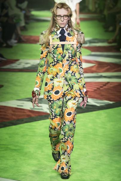 At the Gucci Spring/Summer 2017 show, many models wore clothes in the Greenery color while walking down a Greenery-colored runway.