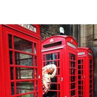 Elsa Hosk poses next to a London phonebox