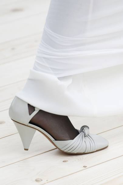 4. Step out in the cone heel shoe