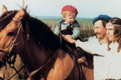 A young Gabriela learning to ride with her parents at their ranch in Uruguay
