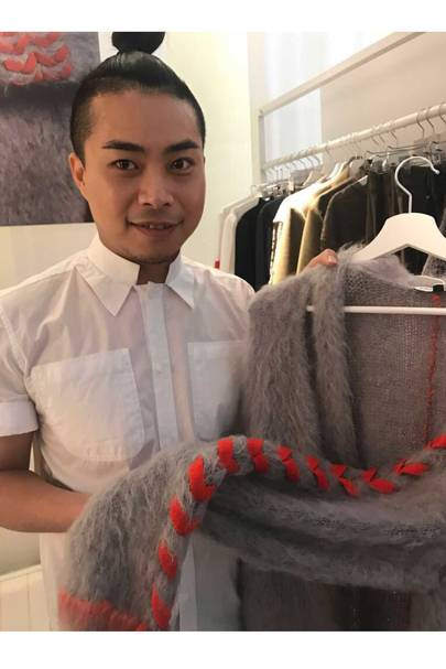 Chris Ran Lin with one of his bespoke knitwear designs