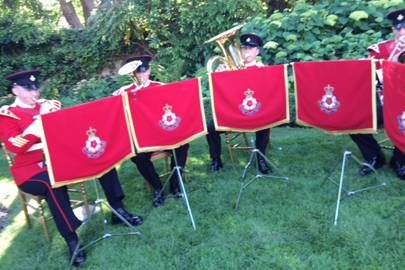 The Queen's band play some military music.