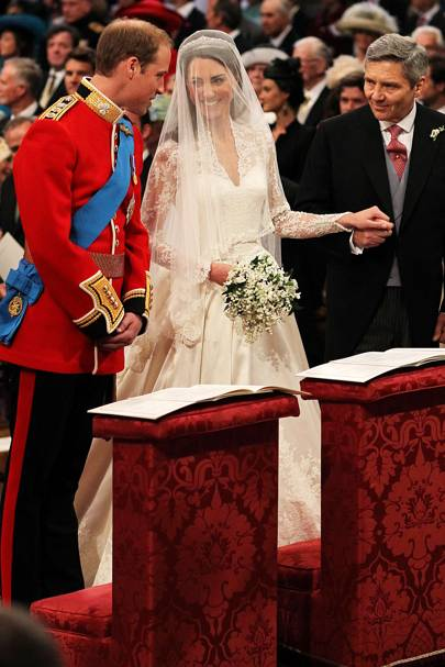 """The father of the bride, Michael Middleton, delivers his daughter to her groom.    <A target=""""_blank"""" href=""""http://www.vogue.co.uk/news/favourites-of-vogue/110111-royal-wedding-what-to-wear-.aspx"""">[b]THE CHICEST BUYS FOR A FASHIONABLE WEDDING[/b]</a>"""
