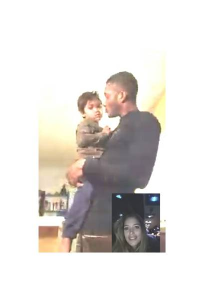 Doutzen Kroes skyping with husband Sunnery and son Phyllon from London