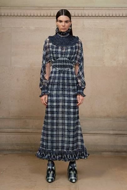 designer for givenchy 5rv7  Angelica wears a silk chiffon tartan-print dress embellished with red  mirror-effect crystals and delicate pliss茅 soleil at the waist, neck and  hem;