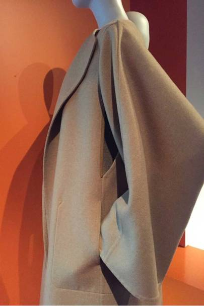 A camel coat by Martin Margiela for Hermès, showcasing his fluid drapery and love of hidden details, such as the slit in the underarm to enable ease of movement and, if the arms are put inside the opening, to wear the coat as a cape