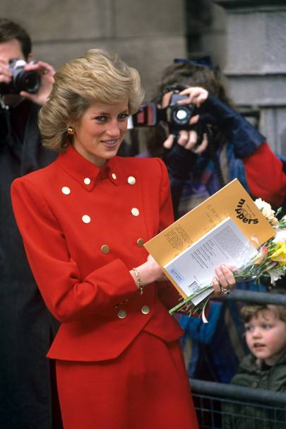 """1989 - She chose a military-inspired red suit with gold buttons for a visit to St Mary's Hospital in Paddington.   <A target=""""_blank"""" href=""""http://www.vogue.co.uk/news/fashion/street-trends/110429-lola-bukvic--royal-wedding.aspx"""">[b]SEE THE MOST STYLISH REAL-LIFE WEDDING WATCHERS[/b]</a>  <A target=""""_blank"""" href=""""http://www.vogue.co.uk/celebrity-photos/110415-style-file--the-queen/gallery.aspx"""">[b]SEE THE QUEEN'S STYLE FILE[/b]</a>"""