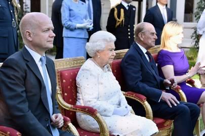 Thrones waiting for Queen Elizabeth II, Prince Philip, Duke of Edinburgh, Foreign Secretary William Hague and his wife Ffion Hague.