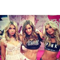 Stella Maxwell, Josephine Skriver and Elsa Hosk prepare to walk in the Pink section of the show