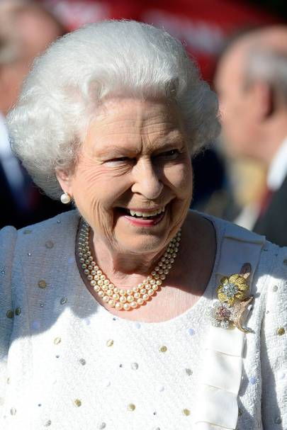 The Queen attends a garden party at the British Embassy during an official visit to Paris, ahead of the 70th Anniversary of World War Two's D-Day, wearing a white Angela Kelly outfit.